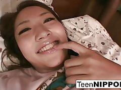 Young Asian woman plays wide their way in summary nipples & penurious pussy